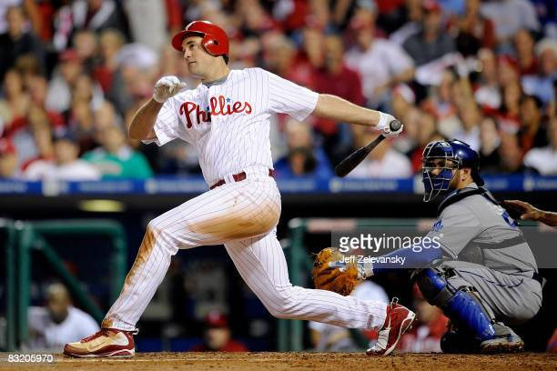 Pat Burrell of of the Philadelphia Phillies hits a solo home run to give the Phillies a 3-2 lead in the bottom of the sixth inning against the Los...