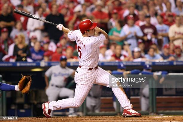 Pat Burrell of of the Philadelphia Phillies hits a solo home run to give the Phillies a 32 lead in the bottom of the sixth inning against the Los...