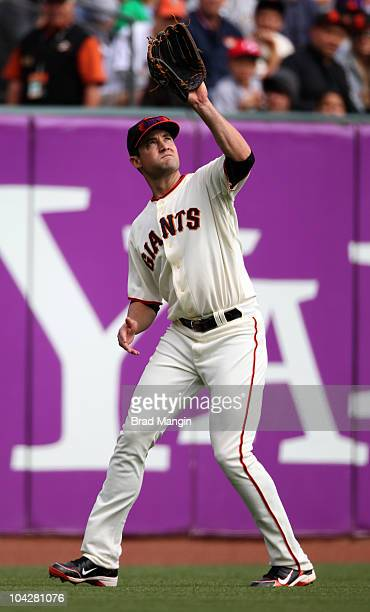 Pat Burrell of the San Francisco Giants catches a fly ball in left field against the Milwaukee Brewers during the game at ATT Park on September 19...