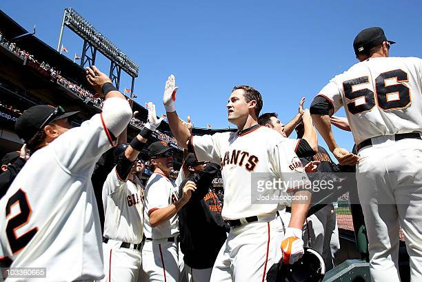Pat Burrell of the San Francisco Giants celebrates after hitting a grand slam against the Chicago Cubs in the fifth inning during an MLB game at ATT...