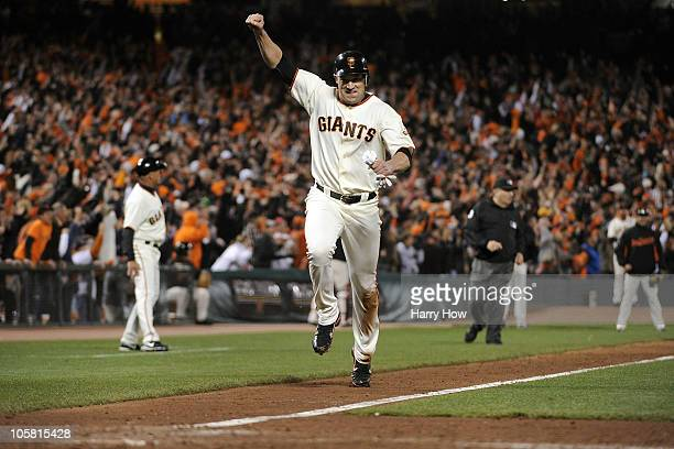 Pat Burrell of the San Francisco Giants celebrates as he scores on a double by Pablo Sandoval in the sixth inning of Game Four of the NLCS during the...