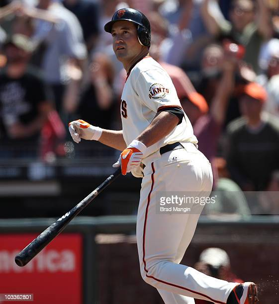 Pat Burrell of the San Francisco Giants hits a grand slam against the Chicago Cubs during the game at ATT Park on August 12 2010 in San Francisco...
