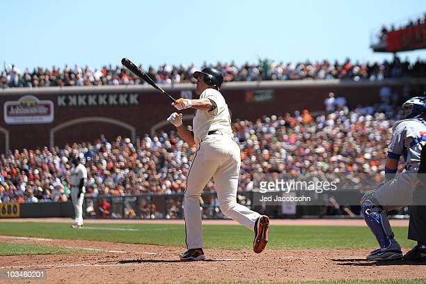 Pat Burrell of the San Francisco Giants hits a grand slam against the Chicago Cubs in the fifth inning during an MLB game at ATT Park on August 12...