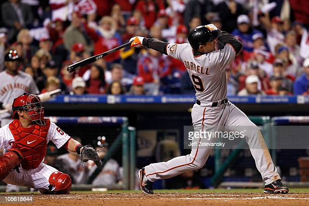 Pat Burrell of the San Francisco Giants hits a RBI double in the sixth inning in Game One of the NLCS during the 2010 MLB Playoffs at Citizens Bank...
