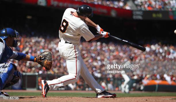 Pat Burrell of the San Francisco Giants hits a tworun home run in the bottom of the 8th inning against the Los Angeles Dodgers during the game at ATT...