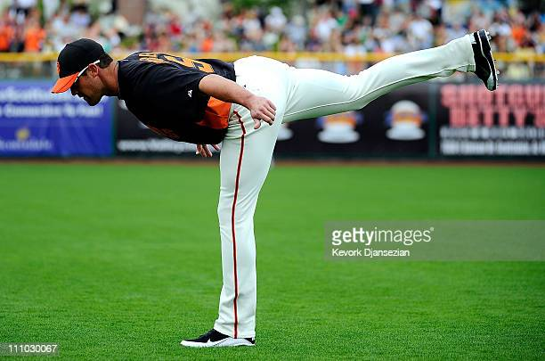 Pat Burrell of the San Francisco Giants warms up before playing against the Milwaukee Brewers in the spring training baseball game at Scottsdale...