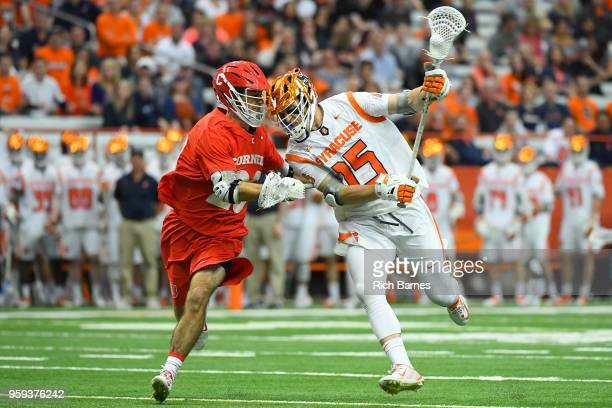 Pat Carlin of the Syracuse Orange dodges to the goal against the defense of Ryan Bray of the Cornell Big Red during a 2018 NCAA Division I Men's...