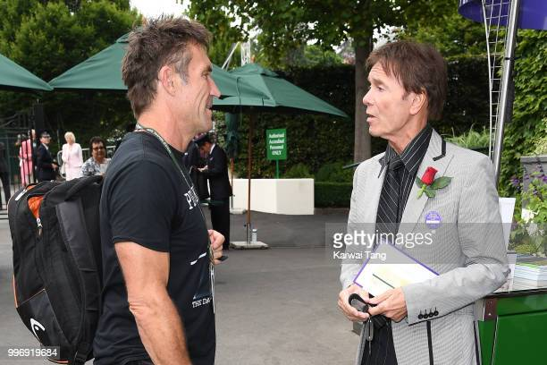 Pat Cash and Cliff Richard attend day ten of the Wimbledon Tennis Championships at the All England Lawn Tennis and Croquet Club on July 12 2018 in...