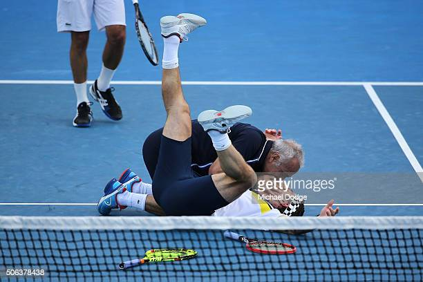 Pat Cash and Mansour Bahrami share a joke during their legends match during day six of the 2016 Australian Open at Melbourne Park on January 23 2016...