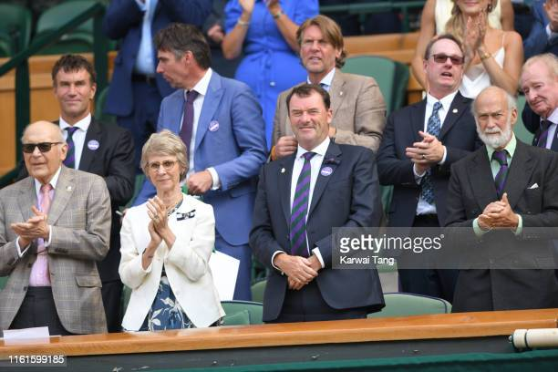 Pat Cash, Birgitte, Duchess of Gloucester, Wimbledon Chairman Philip Brook and Prince Michael of Kent on Centre Court during day eleven of the...
