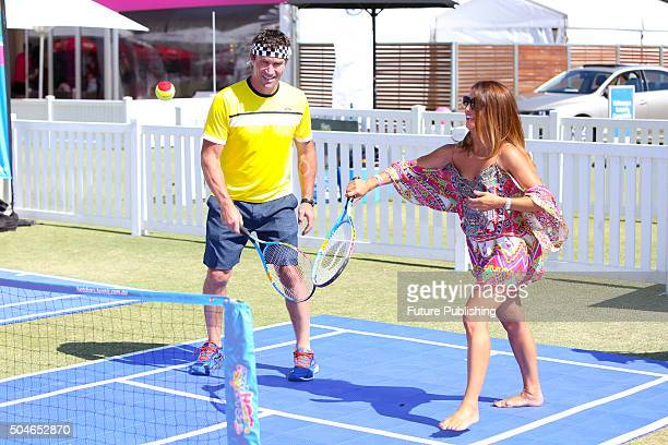 Pat Cash helps Ada Nicodemou while playing with Samantha Harris and Ash Williams on Day 1 of the 2016 Kooyong Classic on January 12 2016 in Melbourne...