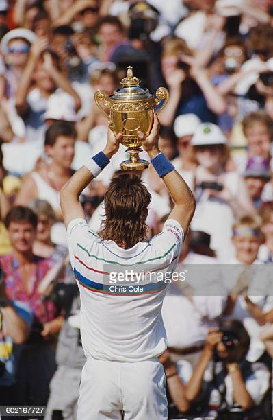 Pat Cash of Australia holds aloft the trophy after winning the Men's Singles Final against Ivan Lendl at the Wimbledon Lawn Tennis Championship on 5...