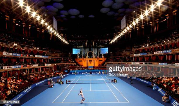 Pat Cash of Australia serves to Richard Kajicek of Holland during Day One of the AEGON Masters Tennis at Royal Albert Hall on November 30, 2011 in...