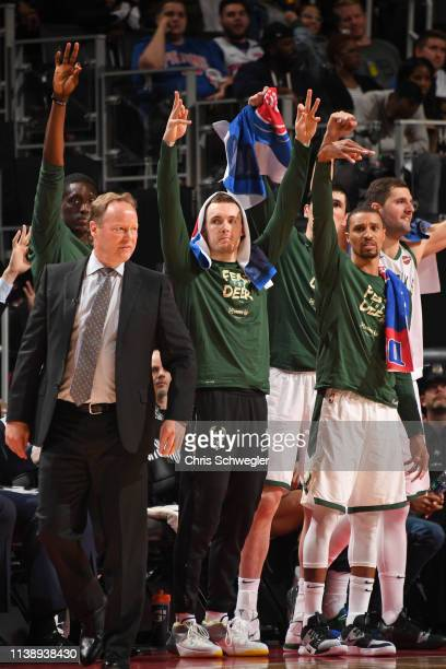 Pat Connaughton and George Hill of the Milwaukee Bucks react to a play against the Detroit Pistons during Game Four of Round One of the 2019 NBA...