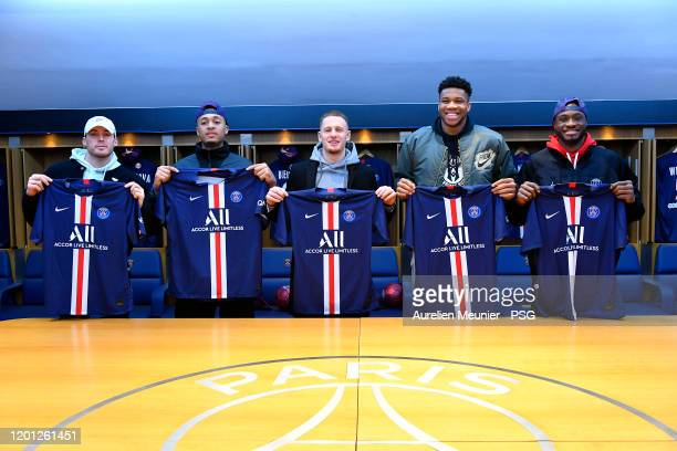 Pat Connaughton, Cameron Reynolds, Donte Divicenzo, Giannis Antetokounmpo and Thanasis Antetokounmpo of the Milwaukee Bucks pose in the Paris...