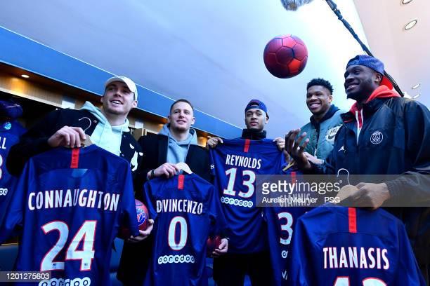 Pat Connaughton, Donte Divicenzo, Cameron Reynolds, Giannis Antetokounmpo and Thanasis Antetokounmpo of the Milwaukee Bucks pose in the Paris...
