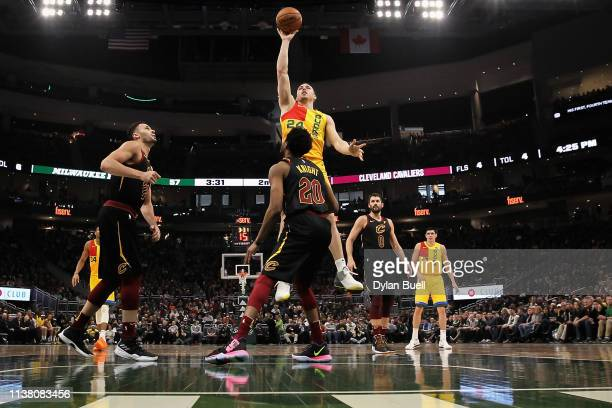 Pat Connaughton of the Milwaukee Bucks attempts a shot while being guarded by Brandon Knight of the Cleveland Cavaliers in the second quarter at the...