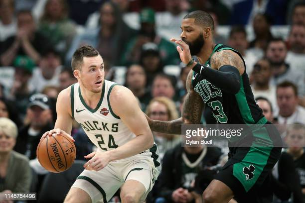 Pat Connaughton of the Milwaukee Bucks dribbles the ball while being guarded by Marcus Morris of the Boston Celtics in the first quarter during Game...