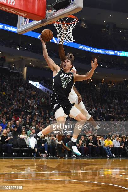 Pat Connaughton of the Milwaukee Bucks drives to the basket against Josh Jackson of the Phoenix Suns during the first half of a game at Fiserv Forum...