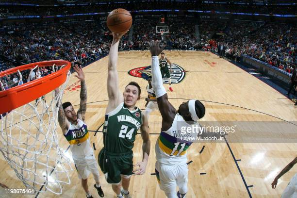Pat Connaughton of the Milwaukee Bucks drives to the basket against the New Orleans Pelicans on February 4 2020 at the Smoothie King Center in New...