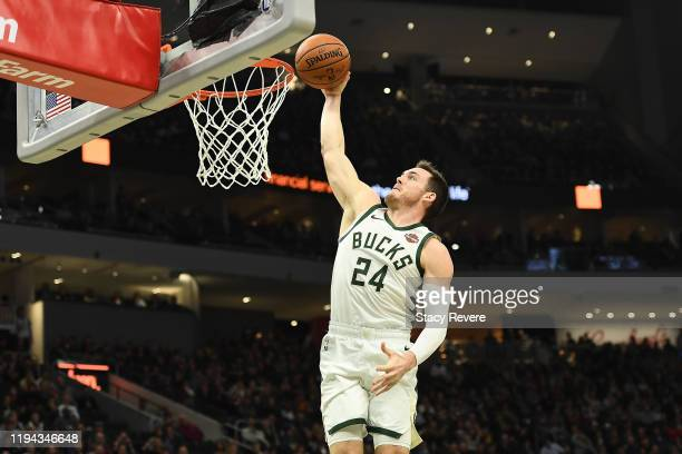 Pat Connaughton of the Milwaukee Bucks dunks against the Cleveland Cavaliers during the second half of a game at Fiserv Forum on December 14 2019 in...