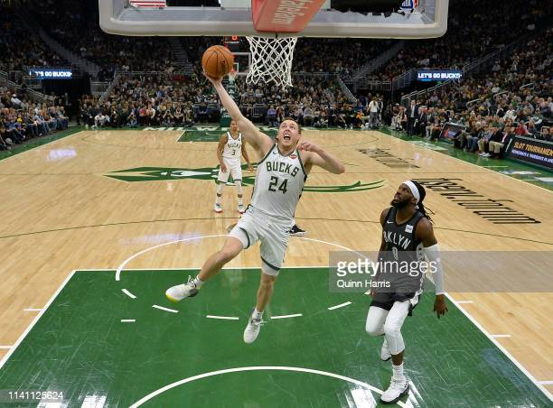 Pat Connaughton of the Milwaukee Bucks dunks in the second half against the Brooklyn Nets at Fiserv Forum on April 06 2019 in Milwaukee Wisconsin...