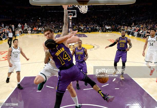 Pat Connaughton of the Milwaukee Bucks dunks the ball against Brandon Ingram of the Los Angeles Lakers during the game at Staples Center on March 01...
