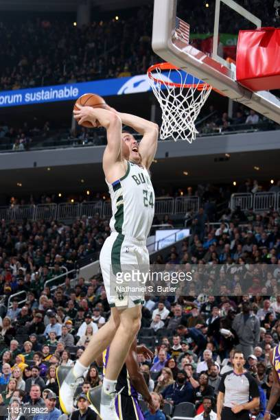 Pat Connaughton of the Milwaukee Bucks dunks the ball against the Los Angeles Lakers on March 19 2019 at the Fiserv Forum Center in Milwaukee...