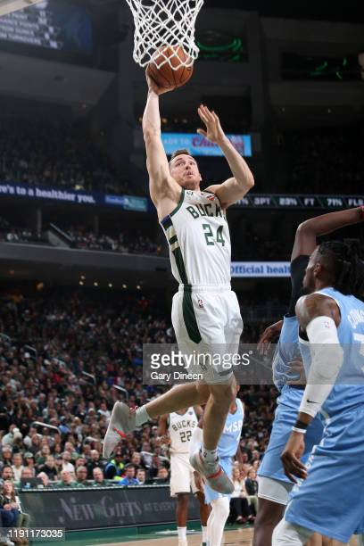 Pat Connaughton of the Milwaukee Bucks dunks the ball against the Minnesota Timberwolves on January 1 2020 at the Fiserv Forum Center in Milwaukee...
