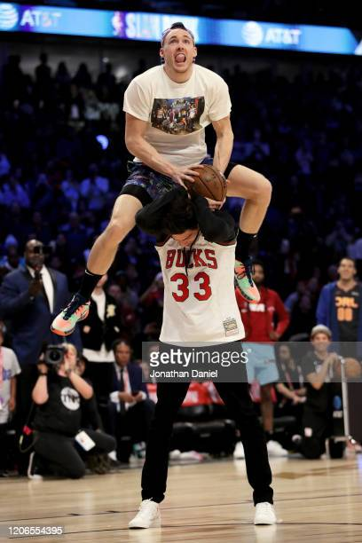 Pat Connaughton of the Milwaukee Bucks dunks the ball over Christian Yelich of the Milwaukee Brewers in the 2020 NBA AllStar ATT Slam Dunk Contest...