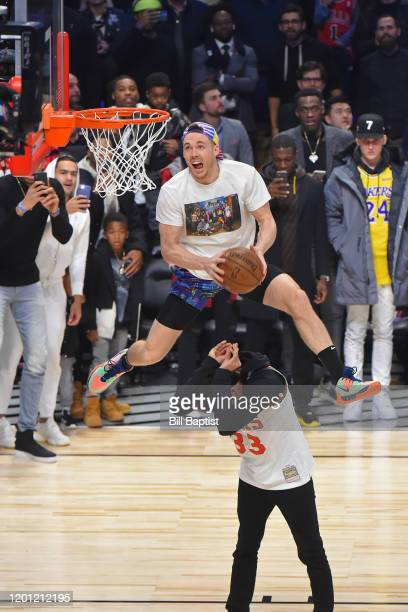 Pat Connaughton of the Milwaukee Bucks dunks the ball over MLB Player Christian Yelich during the ATT Slam Dunk as part of 2020 NBA AllStar Weekend...