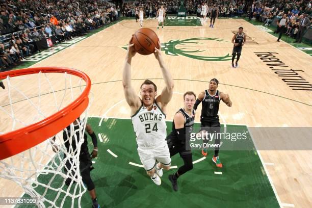 Pat Connaughton of the Milwaukee Bucks goes to the basket against the Detroit Pistons during Game Two of Round One of the 2019 NBA Playoffs against...