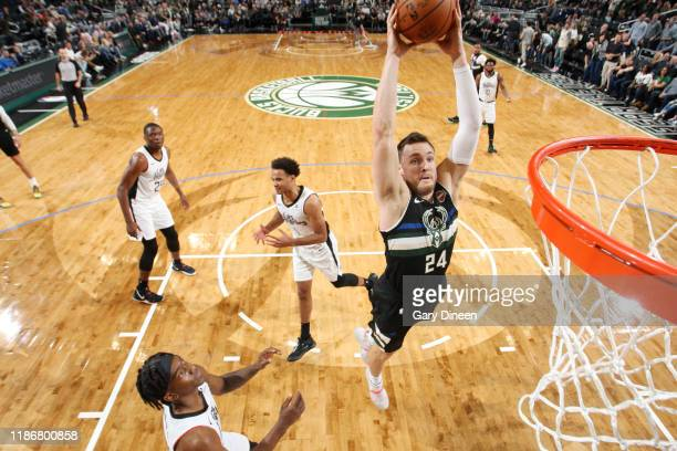 Pat Connaughton of the Milwaukee Bucks goes up for a dunk during the game against the LA Clippers on December 6 2019 at the Fiserv Forum Center in...