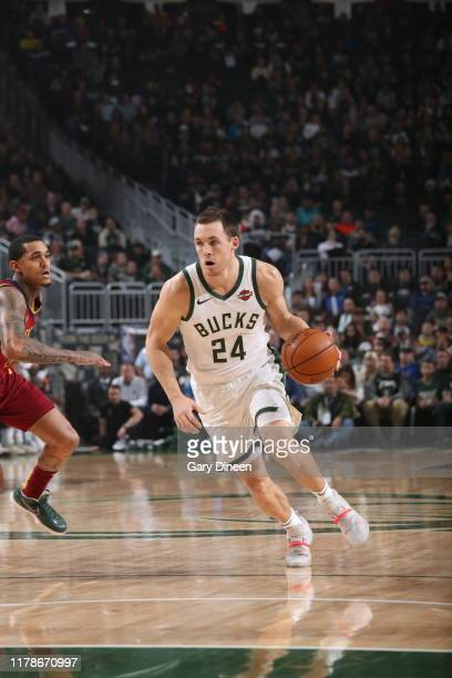 Pat Connaughton of the Milwaukee Bucks handles the ball against the Cleveland Cavaliers on October 28 2019 at the Fiserv Forum Center in Milwaukee...