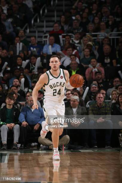 Pat Connaughton of the Milwaukee Bucks handles the ball against the Detroit Pistons on November 23 2019 at the Fiserv Forum Center in Milwaukee...
