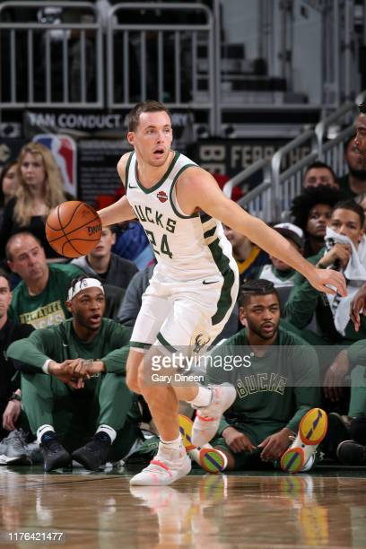 Pat Connaughton of the Milwaukee Bucks handles the ball during a preseason game against the Minnesota Timberwolves on October 17 2019 at the Fiserv...