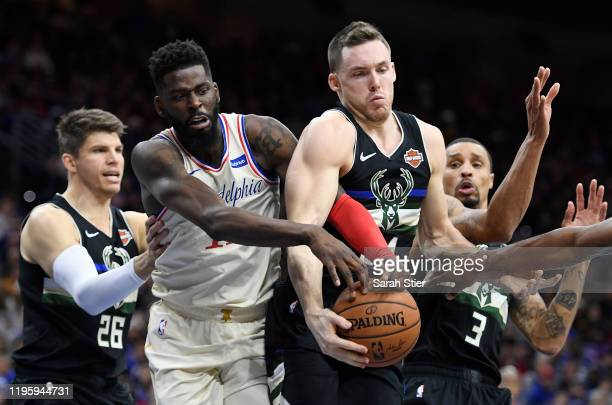 Pat Connaughton of the Milwaukee Bucks jostles James Ennis III of the Philadelphia 76ers for the ball during the second half of the game at Wells...