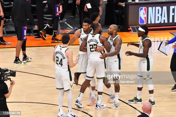 Pat Connaughton of the Milwaukee Bucks, Khris Middleton of the Milwaukee Bucks, Giannis Antetokounmpo of the Milwaukee Bucks, P.J. Tucker of the...