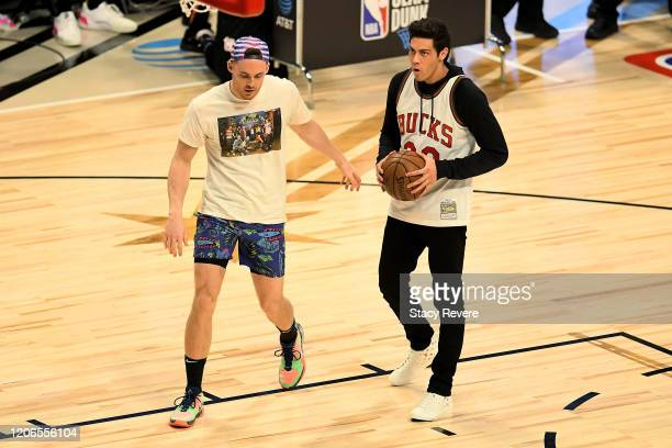 Pat Connaughton of the Milwaukee Bucks sets up Christian Yelich of the Milwaukee Brewers in the 2020 NBA AllStar ATT Slam Dunk Contest during State...