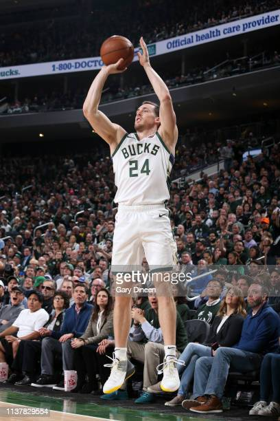 Pat Connaughton of the Milwaukee Bucks shoots a three point basket against the Detroit Pistons during Game Two of Round One of the 2019 NBA Playoffs...
