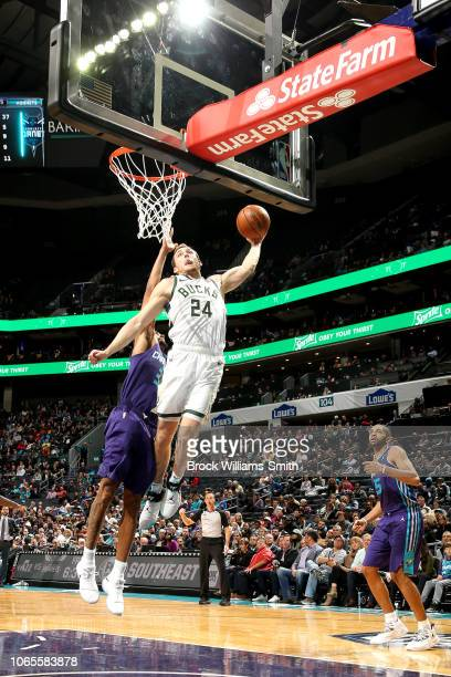 Pat Connaughton of the Milwaukee Bucks shoots the ball against the Charlotte Hornets on November 26 2018 at Spectrum Center in Charlotte North...