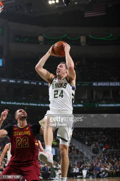 Pat Connaughton of the Milwaukee Bucks shoots the ball against the Cleveland Cavaliers on October 28 2019 at the Fiserv Forum Center in Milwaukee...