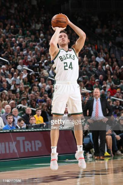 Pat Connaughton of the Milwaukee Bucks shoots the ball against the Indiana Pacers on December 22 2019 at the Fiserv Forum Center in Milwaukee...