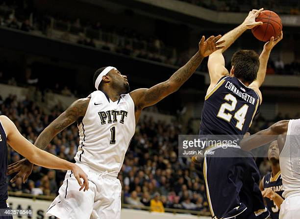 Pat Connaughton of the Notre Dame Fighting Irish and Jamel Artis of the Pittsburgh Panthers battle for a rebound during the game at Petersen Events...