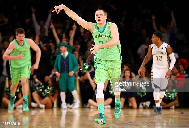Pat Connaughton of the Notre Dame Fighting Irish celebrates after he made a 3-point shot in the second half against the Marquette Golden Eagles...