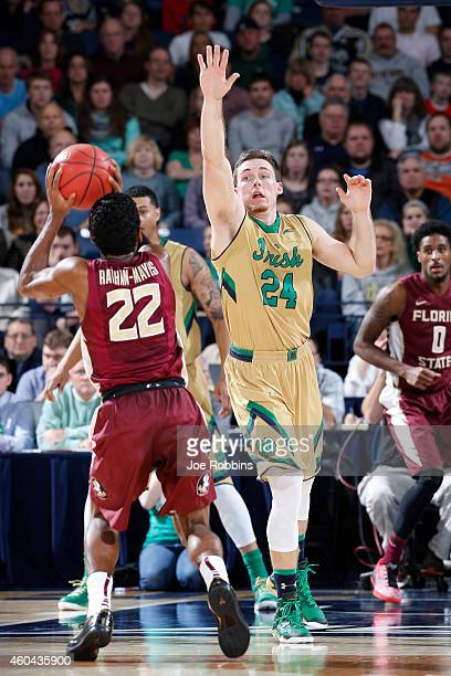 Pat Connaughton of the Notre Dame Fighting Irish defends against Xavier RathanMayes of the Florida State Seminoles during the game at Purcell...