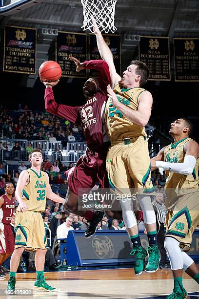 Pat Connaughton of the Notre Dame Fighting Irish defends against Montay Brandon of the Florida State Seminoles during the game at Purcell Pavilion on...