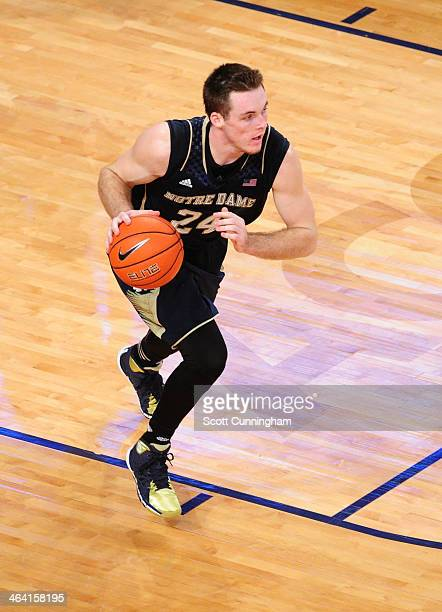 Pat Connaughton of the Notre Dame Fighting Irish drives against the Georgia Tech Yellow Jackets at McCamish Pavilion on January 11 2014 in Atlanta...