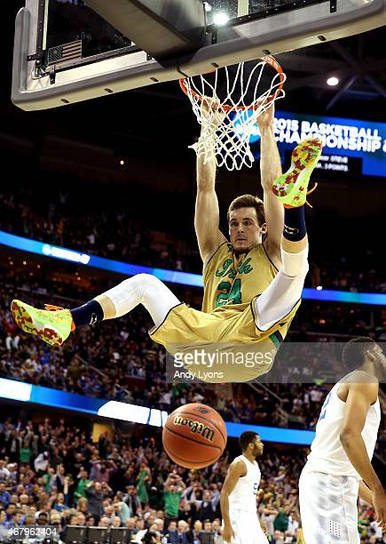 Pat Connaughton of the Notre Dame Fighting Irish dunks in the second half against the Kentucky Wildcats during the Midwest Regional Final of the 2015...