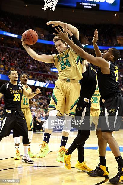 Pat Connaughton of the Notre Dame Fighting Irish gets a rebound against Darius Carter of the Wichita State Shockers in the second half during the...